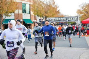 Runners were bundled up against the cold at the start of the 2017 Veteran's Day 5K