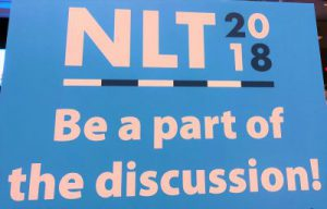 "AGA NLT 2018 sign, ""Be a part of the discussion!"""