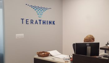The front desk at our HQ in Reston, VA proudly shows the TeraThink logo