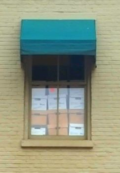 Looking at these boxes of records in the window you have to wonder if the retention is driven by how much space they have or actual business need.